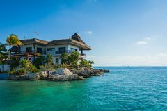 House on the rocks by the sea Stock Image