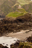 House on the Rocky Coastline Stock Images