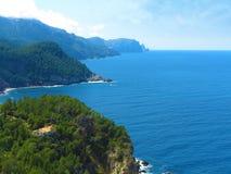 House, rocky coastline and the sea Royalty Free Stock Photo