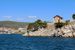 House on the rocky island on the sea way to city Sibenik, Croatia Stock Photography