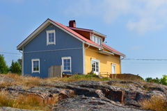 House on the rocky shore Stock Photo