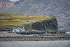 House on the rocky shore Royalty Free Stock Photography
