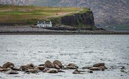 House on the rocky shore Stock Photos