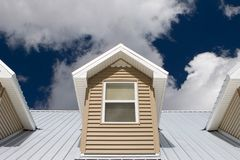 House roof. Under cloudy skies Stock Photos
