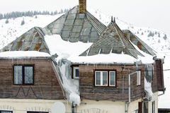 House roof. A house roof with icicles in mountain landscape royalty free stock photos