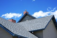 House Roof. Roofing Works. Cloudy Blue Sky. American Building Style stock images