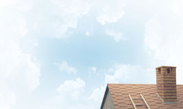 House roof as concept of suburbian real estate and construction. Stock Photo