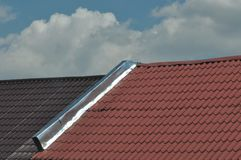 House roof detail. House roof with blue sky on the background Stock Photography