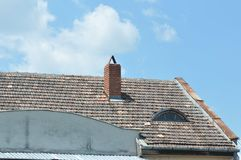House roof detail. House roof with blue sky on the background Royalty Free Stock Photo