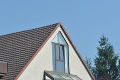 Roof from modern house. House roof with blue sky on the background Royalty Free Stock Image