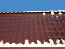 House roof from brown metal tile closeup Stock Image