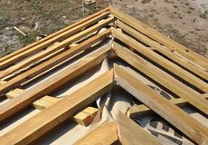 House Roof Corner Roofing Construction. Install House Roof with Wooden Trusses and Insulation Membrane. House Roof Corner Construction. Install House Roof with royalty free stock photos