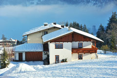 House with roof cover by snow in Alps Stock Photos
