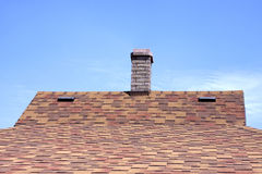 House roof covered with a bitumen tile Royalty Free Stock Images