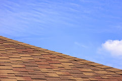 House roof covered with a bitumen tile Stock Photo