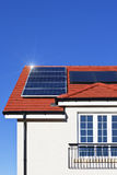 House roof covered with solar panels. Alternative energy photovoltaic solar panels on tiled house roof Royalty Free Stock Photography