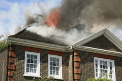 House roof on fire Stock Photo