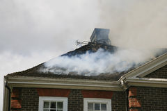 House roof on fire Stock Photography