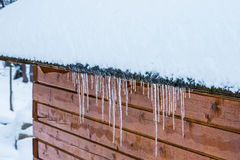 House roof icicles Royalty Free Stock Images