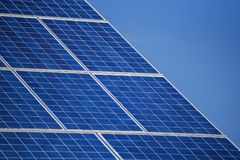 House roof with a solar panels. On top royalty free stock photos