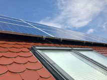 House roof with solar panels on top Royalty Free Stock Photography