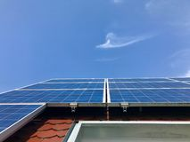 House roof with solar panels on top Stock Images