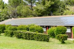House roof with a solar panels on top. Close-up of a house roof with a solar panels on top royalty free stock image