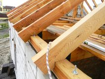 Roofing construction with wooden beams, logs, rafters, trusses. House Roofing construction with wooden beams, logs, rafters, trusses royalty free stock images