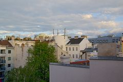 House roofs with clouds. Photo shows details of general house roofs and clouds Stock Image