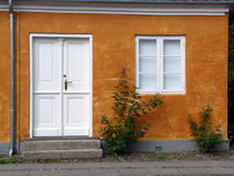 House with rosebush in the historic village of Chr Royalty Free Stock Photo