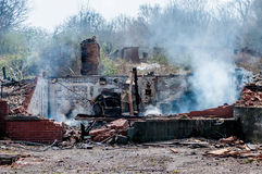 House ruins after fire. Residential house ruins after fire still smoking stock photo