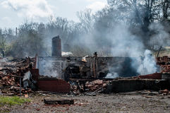 House ruins after fire. Residential house ruins after fire still smoking royalty free stock image