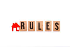 House Rules. Block letters with red home / house icon with white background Royalty Free Stock Photo