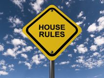 House rules. An yellow traffic sign against blue sky with clouds with the text 'house rules' on it Royalty Free Stock Photos