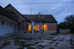 House in rural ambient with beautiful terrace at dawn Stock Images