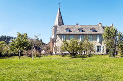 House in a rural village. In France, surrounded by trees on a sunny day Royalty Free Stock Photos