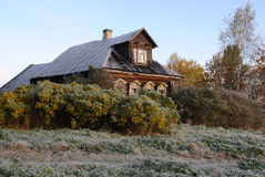 House In The Russian Village in The Late Fall. House in the Russian village on the first frosty morning in the fall Royalty Free Stock Photography