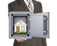 House in safe on mans hand Stock Images