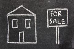 House for sale. Child like chalkboard drawing of a house for sale Stock Image