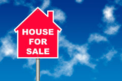 House for Sale. Red House for Sale notice board traffic sign over blue sky background Royalty Free Stock Images