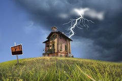 House for sale. Economy threats on an old for sale house Royalty Free Stock Photos