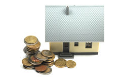 House for sale. Some euro coins and a house for sale Stock Images