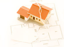 House for sale. On a technical drawing Royalty Free Stock Images