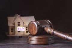 House for sale, auction hammer , symbol of authority and Miniature house . Courtroom concept. House for sale, auction hammer , symbol of authority and Miniature Royalty Free Stock Photo