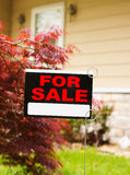 House for Sale. Home put up for sale due to weak economy or just to move up to a bigger house. Focus on the FOR SALE sign Royalty Free Stock Images