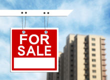 House sale. Real estate sign in front of a house for sale focus on the sign Stock Photography