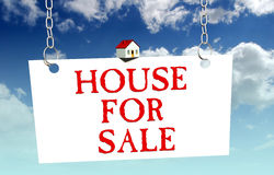 House for sale sign. With a little house on top, on sky background Stock Photos