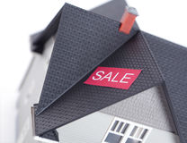 House with sale sign,  on white Stock Images