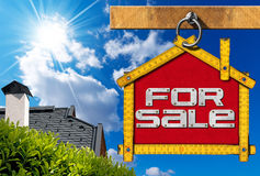 House For Sale Sign - Wooden Meter. Yellow wooden meter ruler in the shape of house with text for sale. For sale real estate sign on blue sky with roof, clouds royalty free illustration