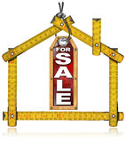 House For Sale - Wood Meter Tool. Wooden yellow meter tool forming a house and hanging tag with written for sale royalty free illustration